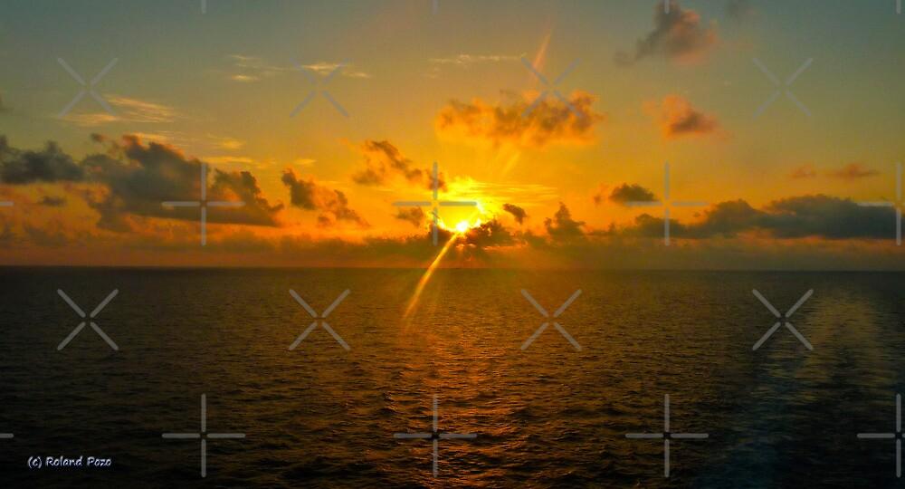 Sunrise at Sea by photorolandi