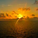 Sunrise at Sea by photorolandi