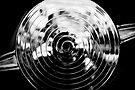 Chrome Spiral Photographer by Bob Larson