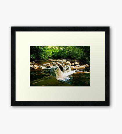 Sunlit Falls Framed Print