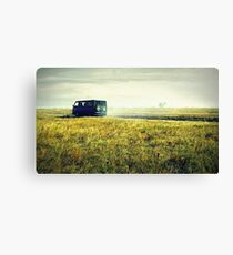 bus sped along the road on the field Canvas Print