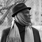 Profile of a Man Wearing a Hat and Scarf – 3 by Cora Wandel