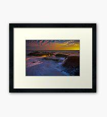 Sunset Spill Framed Print