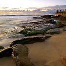 Rocks at the beach by donnnnnny
