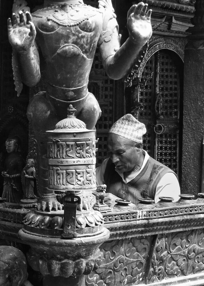 In prayer, Patan, Nepal by John Callaway