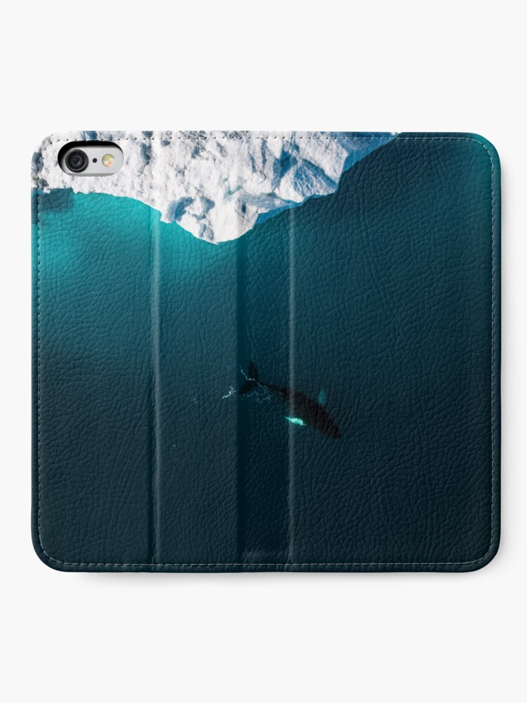 Alternate view of Aerial of a lone Humpback whale in front of an iceberg in Greenland iPhone Wallet