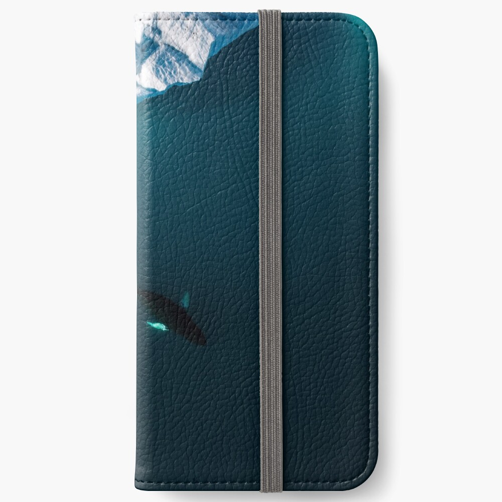 Aerial of a lone Humpback whale in front of an iceberg in Greenland iPhone Wallet