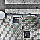 sidewalk, safety tape & road's wrinkles by gregorrogerg