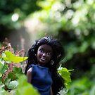 Beautiful black fashion doll in a garden by vannaweb