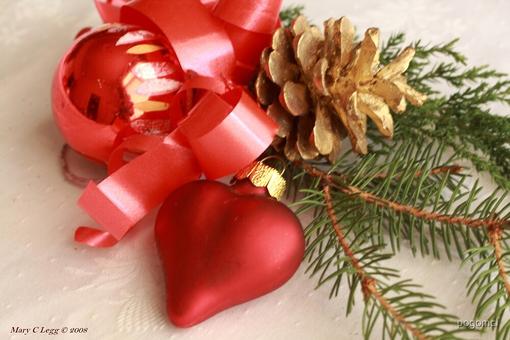 Christmas greens with red heart and ball with gilt pine cone on white damask by pogomcl