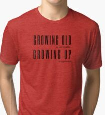 Growing Old is Inevitable Growing Up is Optional Anon Quote Tri-blend T-Shirt