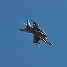 An F-16 Fighting Falcon Banks Hard by Henry Plumley