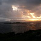 sunset over the islands by Caroline Cage