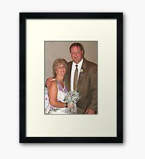 Bride, groom and bouquet Framed Print