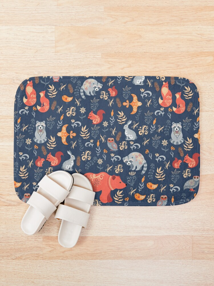 Alternate view of Fairy-tale forest. Fox, bear, raccoon, owls, rabbits, flowers and herbs on a blue background. Bath Mat