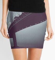 Suspended Above Mini Skirt
