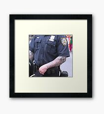 Strong arm of the law Framed Print