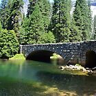 Yosemite National Park landscape photography. Beautiful  lush forest trees, green clear water river and stone bridge. by naturematters
