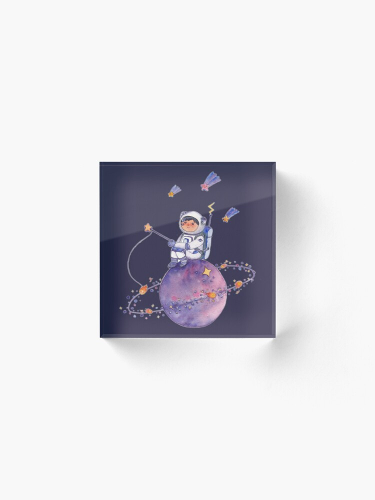 Alternate view of Astronaut catching Asteroids on a Star Acrylic Block