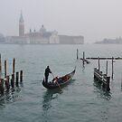 Gondolier in Venice, Italy by revealedrome