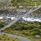 Hanging bridge across highland river at Hooker Valley Track by Sergey Orlov