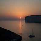Sunset at Xlendi by Christian  Zammit
