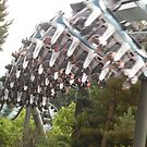 Theme park ride speeding past by JenaHall