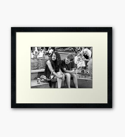 Relaxing at the Fountain Framed Print