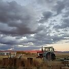 Idaho farm under cloud-filled sky by ChelsiGraphics
