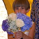 Flower girl and the bridal bouquet by Marjorie Wallace