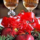 Two fluted wineglasses  stand amongst yew with two crimson  hearts  B by pogomcl