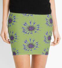 Thin blue flames in a sea of green Mini Skirt