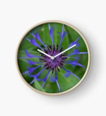 Thin blue flames in a sea of green Clock