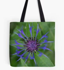 Thin blue flames in a sea of green Tote Bag