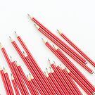 Sharp red HB pencils on white background by Natalie Board