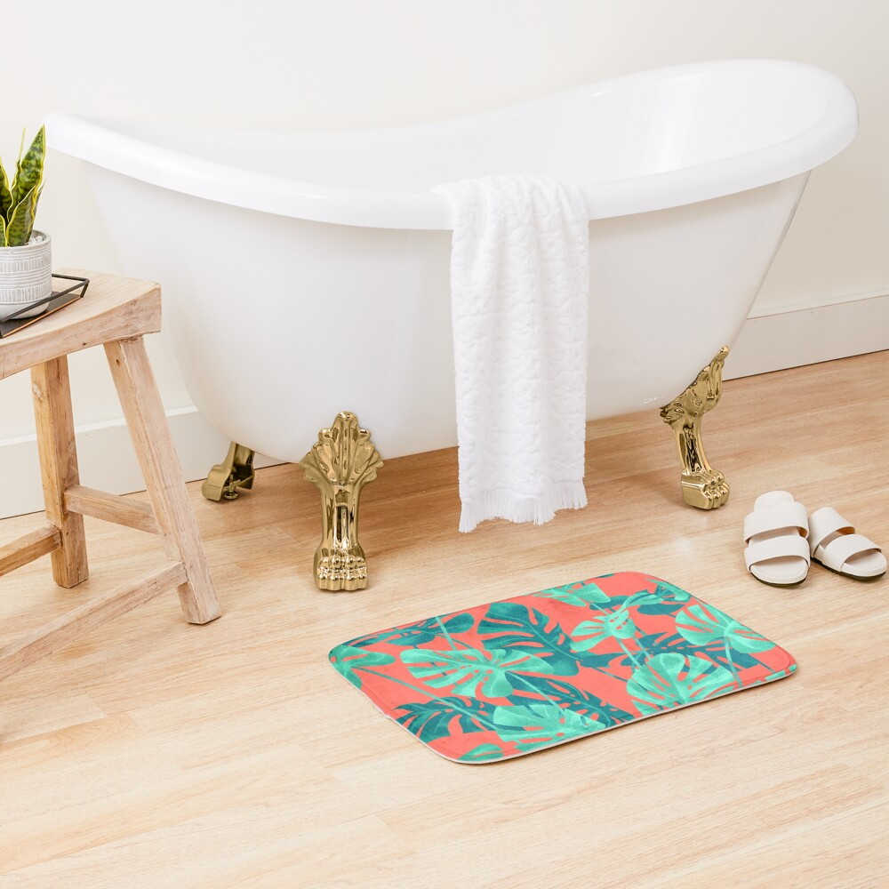 Monstera leaves on living coral. Bath Mat