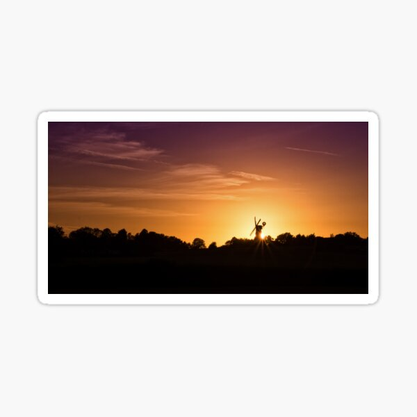 Windmill Sihouetted By The Setting Sun Sticker