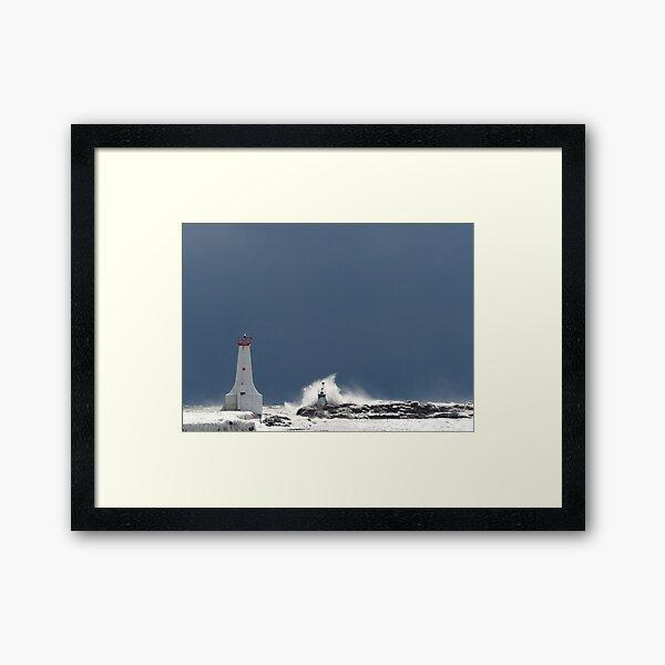 Frozen Lighthouse Facing the Storm Framed Art Print