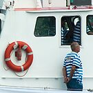 Lifesaver ring and crew on the IJmuiden - close-up by steppeland