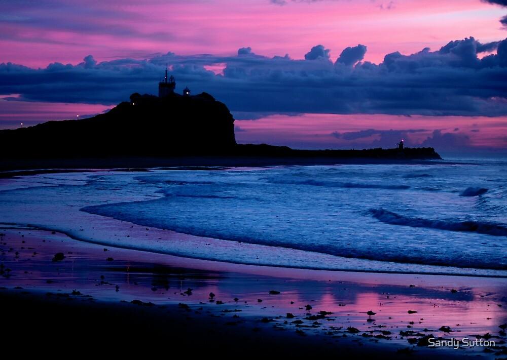 Indigo Dawn - Nobbys Breakwall and Lighthouse by Sandy Sutton