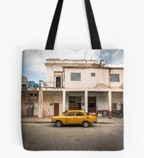Bright yellow vintage car in La Havana, Cuba. Tote Bag