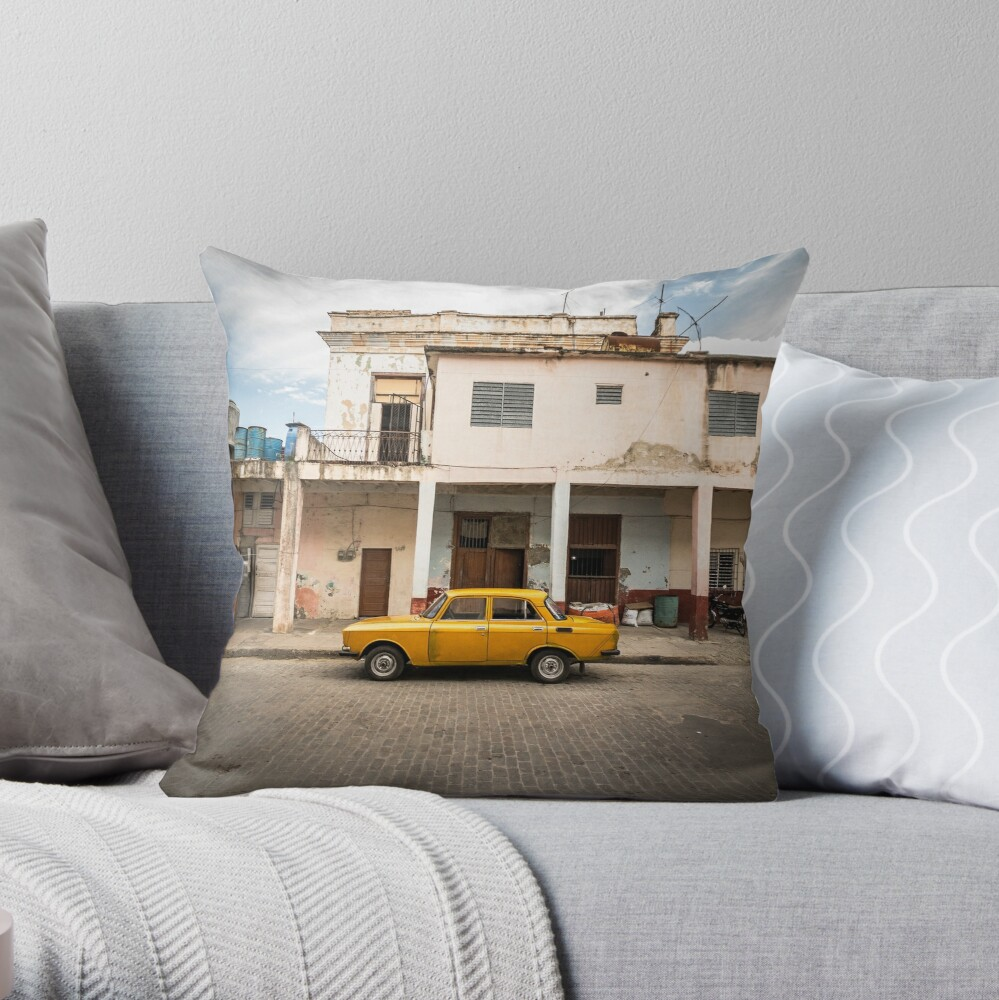 Bright yellow vintage car in La Havana, Cuba. Throw Pillow