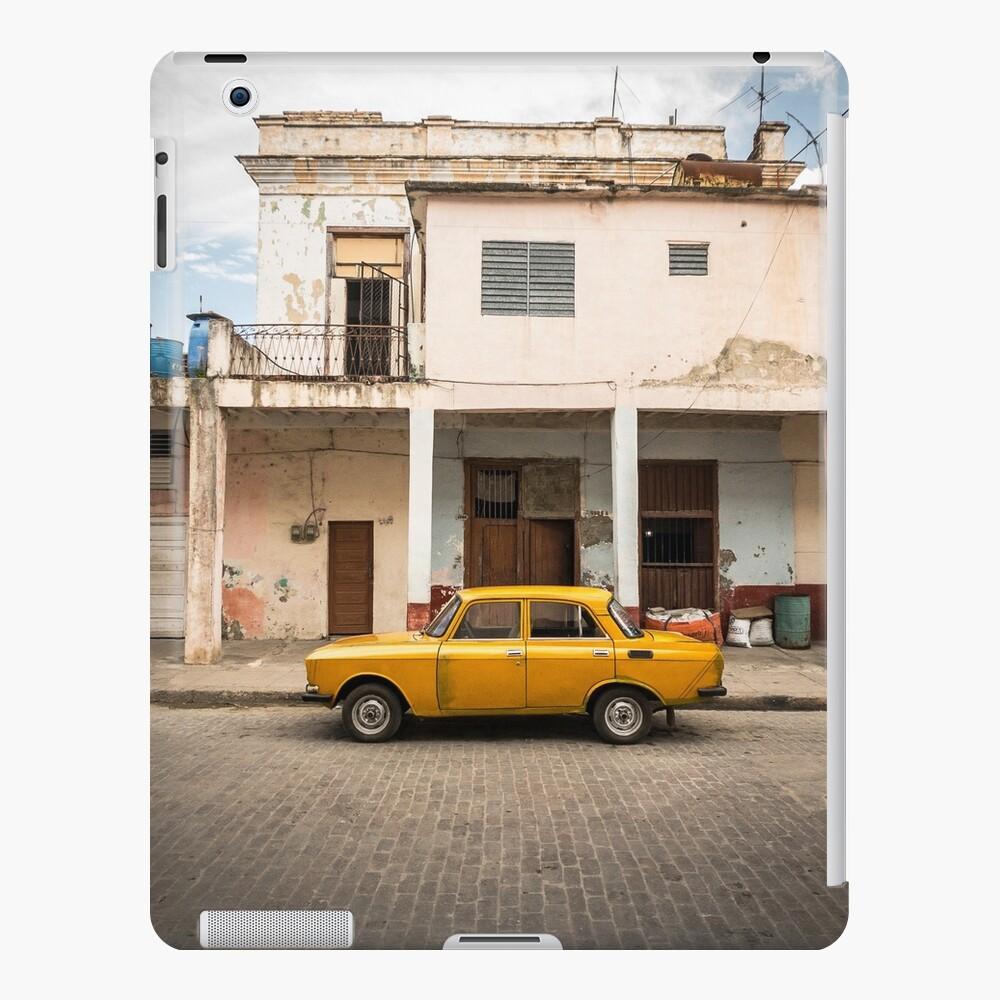 Bright yellow vintage car in La Havana, Cuba. iPad Case & Skin