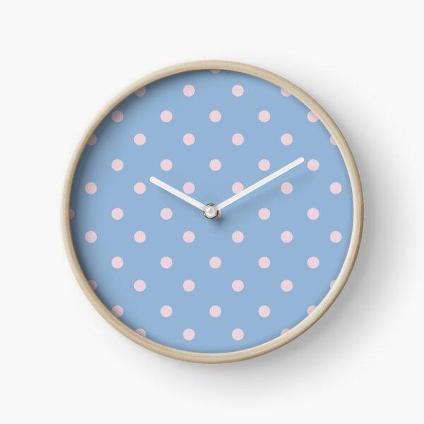 Polka dots pastel pink on blue Clock