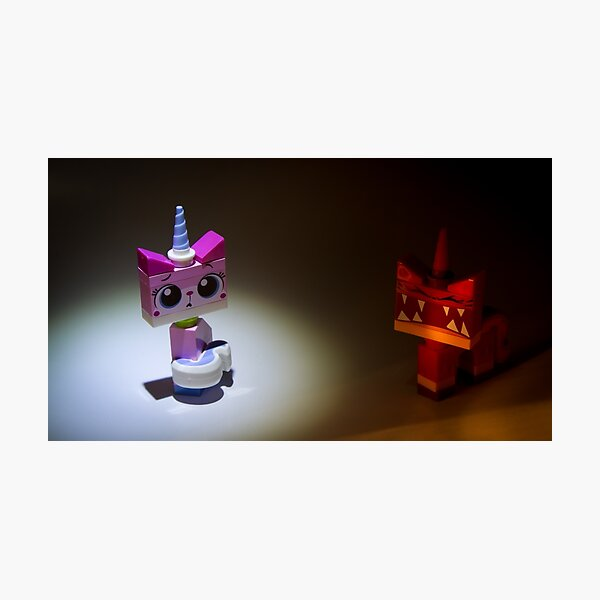 The 2 faces of Unikitty Photographic Print