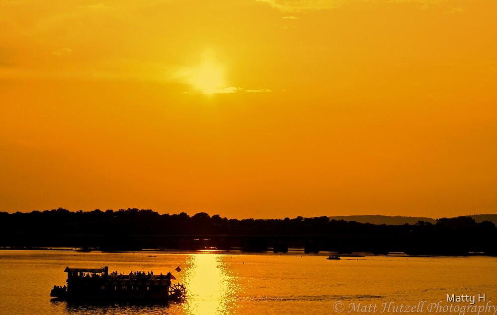 Ferry Under Sunset by Matthew Hutzell