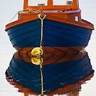 Boat reflection by Gabor Pozsgai