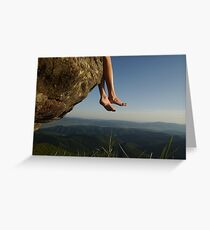 slender female legs on a background of mountains Greeting Card