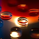Wine Drop Reflections in Candlelight by Sandra Chung