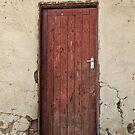 Red wooden door by Angela Ferguson